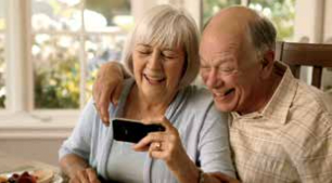 older couple looking at smartphone